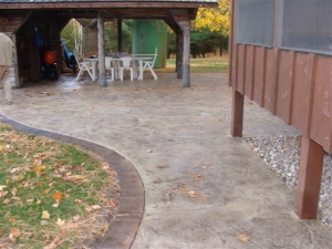 resized_Limestone Patio with Acid stained borders.JPG